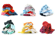 Heaps Of Different Clothes On White Background