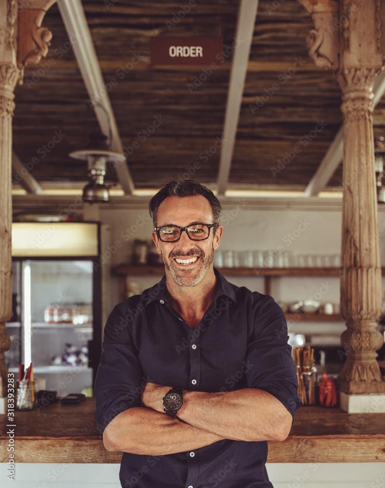 Fototapeta Portrait of a smiling cafe owner