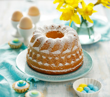 Easter Yeast Cake Sprinkled With Powdered Sugar On A Turquoise Plate. Traditional Easter Dessert In Poland