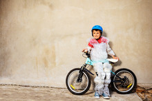 Boy With Bicycle Ball Wear Ove...