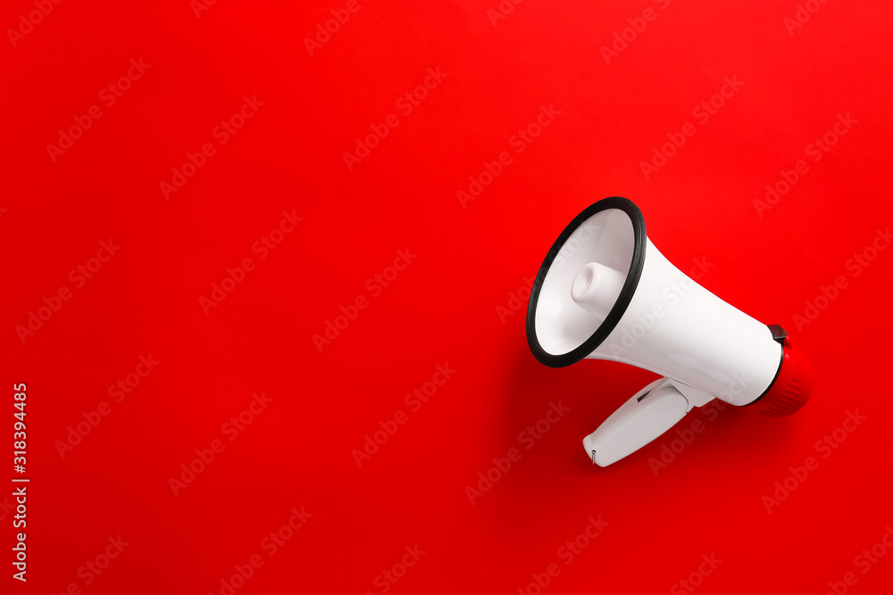 Fototapeta Modern megaphone on color background