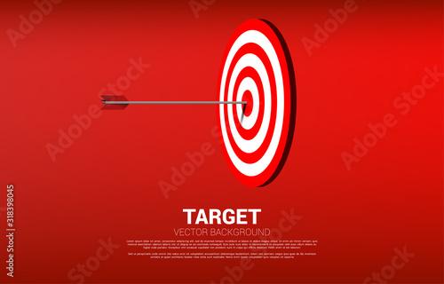 Photo arrow archery hit on the center of dartboard