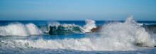 Large Ocean Waves Crash Agains...
