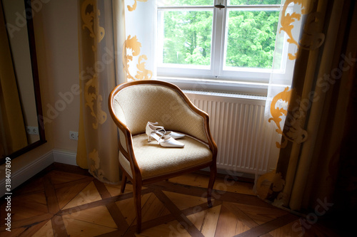 Obraz High Angle View Of Shoes On Chair At Home - fototapety do salonu