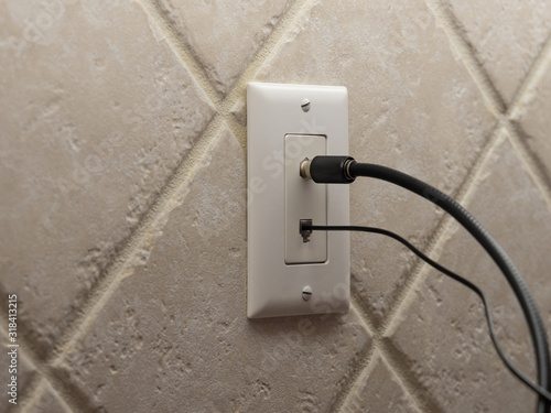 Cuadros en Lienzo Coax cable cord and landline phone cord connected to wall outlet