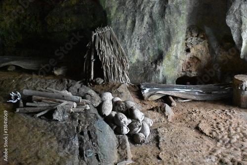 Tent logs and animal skull at Palenque de los Cimarrones cave in Vinales