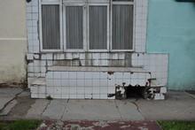 Crumbling White Tiles On Blue Building In Havana