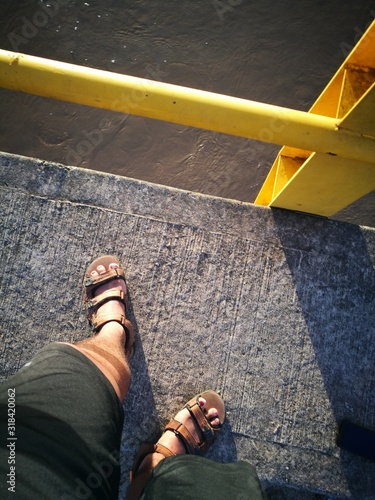 Low Section Of Person Standing On Footbridge Wallpaper Mural