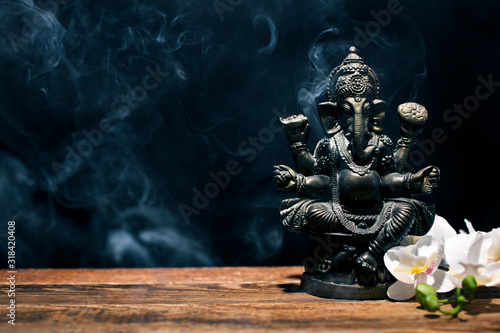 Hindu god Ganesh on black background фототапет