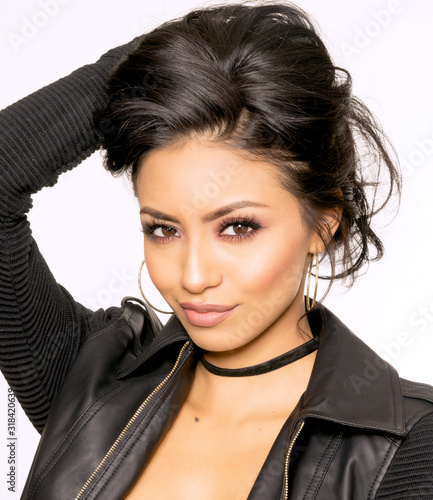 Fototapeta Beautiful face of young woman with long dark hair