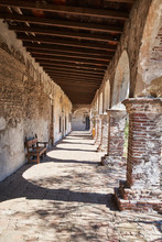 Corridor And Pillars In A Historic Spanish Mission Church In California