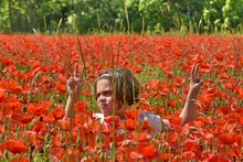 Girl Amidst Poppies Showing Pe...