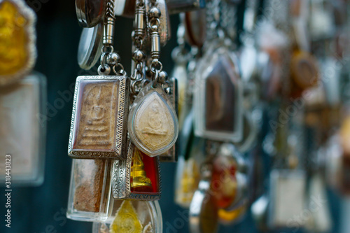 Photo assortment of buddhist amulet sold in market in bangkok -Thailand