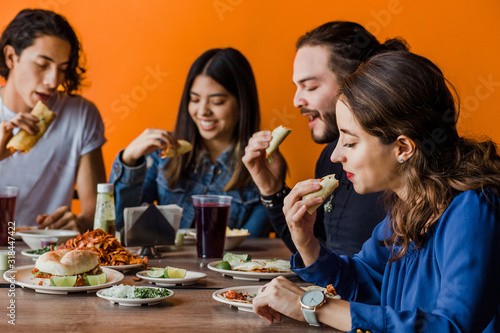 Tacos al Pastor, Mexican people eating in a Taqueria in Mexico Wallpaper Mural