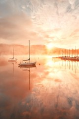 Fototapeta Rzeki i Jeziora Morning foggy lake boat sunrise