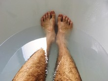 Low Section Of Man In Bathtub