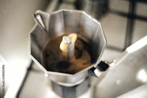 Fotografie, Obraz Close-Up Of Coffee Maker With Open Lid On Table