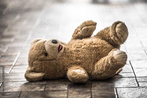 Obraz Close-Up Of Teddy Bear On Floor - fototapety do salonu