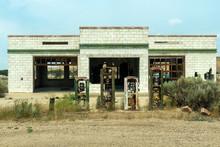 Broken Gas Pumps At An Abandoned Service Station