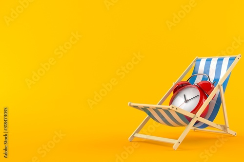 Fotografering Alarm clock on deck chair