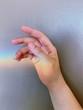 Leinwanddruck Bild - Close-Up Of Hand Against Wall