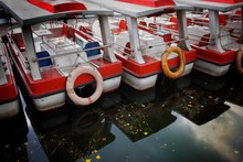 BOATS MOORED IN WATER