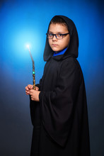A Wizard Boy In Glasses With A...