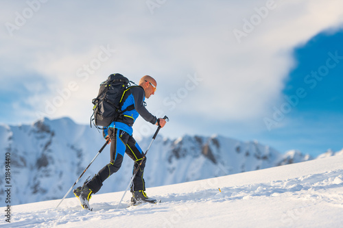 Ski mountaineering in action with seal skins Canvas Print