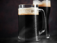 Two Dark Beers Close Up