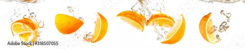 fresh orange with water splash on white