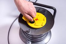 Man Hand Inserts The Plug Into...
