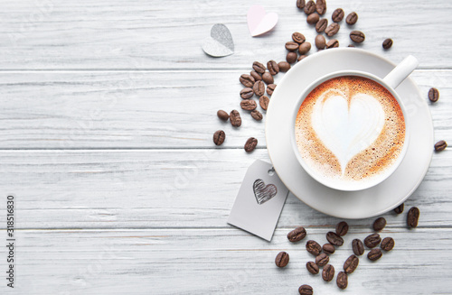 Fototapeta A cup of coffee with heart pattern obraz