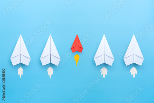 Small business concept with small red paper plane on blue background Canvas Print