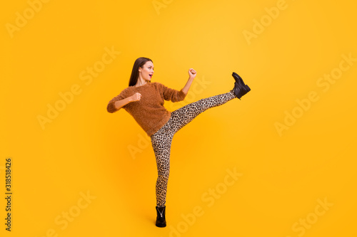 Photo Full length profile photo of funky lady good mood youth look attend self defense