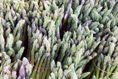 green asparagus in bunches on a bazaar counter Canvas Print