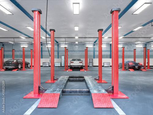 Photo Garage interior with car equipment. 3d illustration