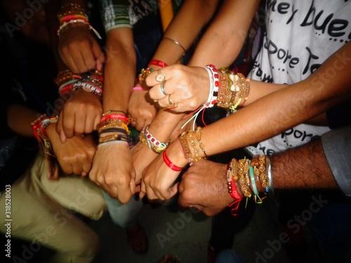 Fototapeta Friends Showing Bracelets At Night