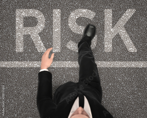 Obraz na plátně Taking risk concept with businessman stepping into the word risk on road, top vi
