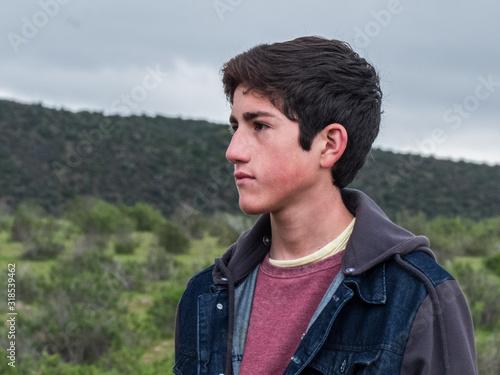 Fotografija Thoughtful Boy Looking Away Against Sky