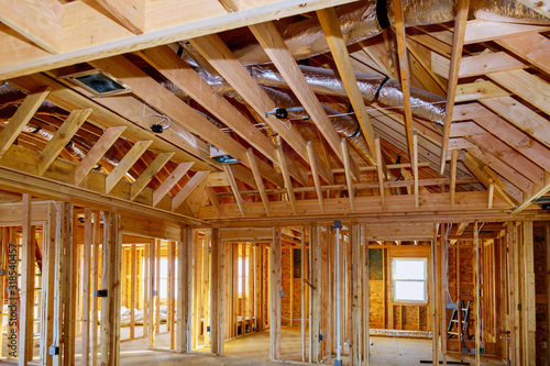 Photo House under construction of wooden beams at construction the roof of air conditi