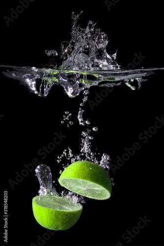 Lime Splashing Water Against Black Background