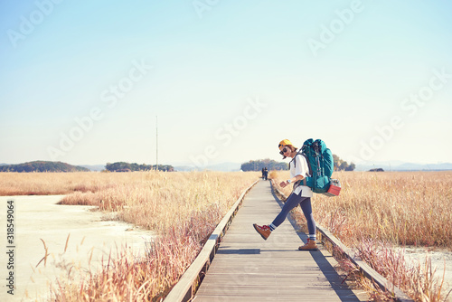 Obraz Korean woman is backpacking on an island in Korea. - fototapety do salonu