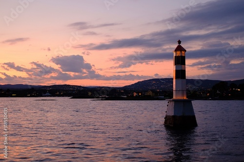 Canvas Print LIGHTHOUSE BY SEA AGAINST SKY DURING SUNSET