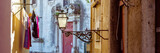 Fototapeta Uliczki - Street lamp and laundry in a picturesque narrow street of Alfama in the old town of Lisbon, Portugal