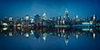 Leinwanddruck Bild - Panorama of the skyline of Manhattan viewed from Jersey city during the blue hour. New York skyline at night with reflections.