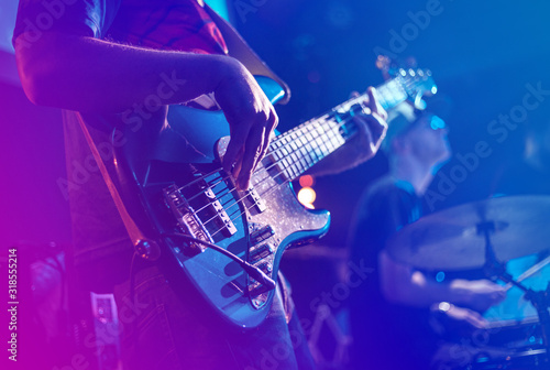 Close up of electric guitar during rock concert