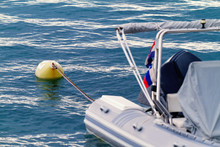 White Motorboat With Yellow Buoy
