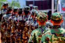 Rear View Of Army Soldiers Standing In Parade