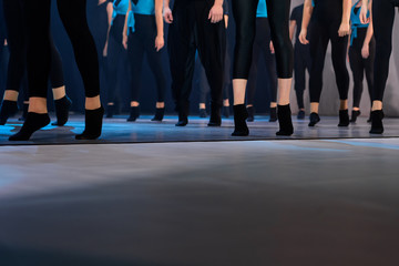 Legs of dancing people in a row in the dance hall salon. Dancing school activity