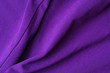 Fragment of crumpled violet polyester wear